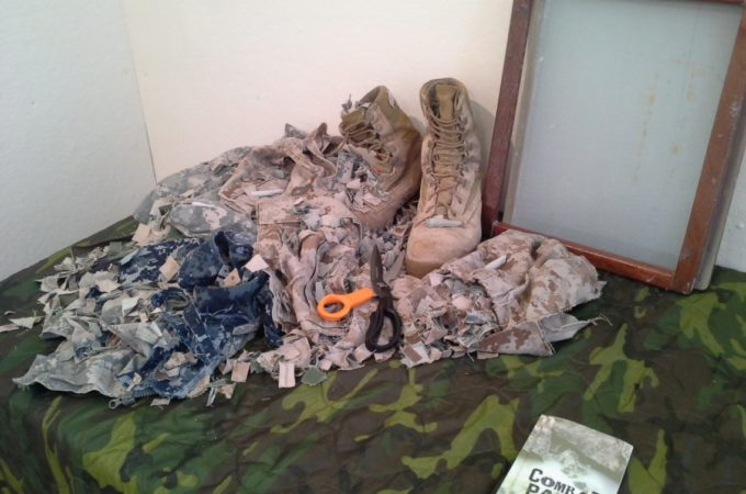 Cut up military uniforms, combat boots and other combat paper making supplies